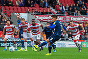 Tom Nichols of Bristol Rovers takes penalty kick but is saved by Seny Dieng Of Doncaster Rovers during the EFL Sky Bet League 1 match between Doncaster Rovers and Bristol Rovers at the Keepmoat Stadium, Doncaster, England on 19 October 2019.