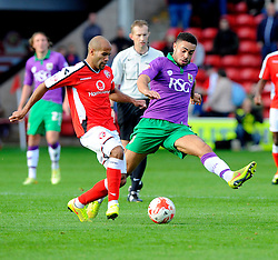 Bristol City's Derrick Williams battles for the ball with Walsall's Adam Chambers  - Photo mandatory by-line: Joe Meredith/JMP - Mobile: 07966 386802 - 04/10/2014 - SPORT - Football - Walsall - Bescot Stadium - Walsall v Bristol City - Sky Bet League One