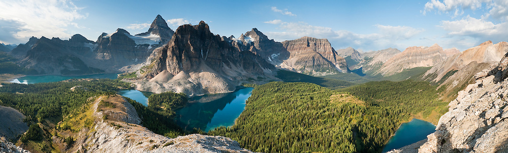 The shoulder of Nub Peak gives an impressive view of Mount Assiniboine (3618 meters / 11,870 feet) and Lake Magog, Sunburst Lake, Cerulean Lake, and Elizabeth Lake (left to right), in Mount Assiniboine Provincial Park, British Columbia, Canada. This is part of the Canadian Rocky Mountain Parks World Heritage Site declared by UNESCO in 1984. Panorama stitched from 5 images.