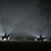 Illuminated by spectators camera flashes, members of the Confederate Cavalry form up in the pre-dawn just before the start of the sunrise battle, a reenactment of the Battle of Pottsville, during the weekend celebration of the Battle of Perryville, which serves as the national Civil War reenactment for 2006, at the Perryville Battlefield in Perryville, Ky. on Oct. 7, 2006. David Stephenson/Staff