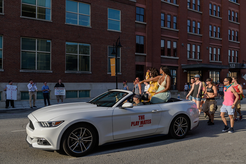 A group of men hold signs and shout about Jesus at The Play Mates and others as they pass.<br /> The Lesbian, Gay, Bisexual, Transgender, and Queer (LGBTQ) community and their friends, family and supporters walked and lined Main Street from Floyd Street to the Belvedere for the Kentuckiana Pride Parade, Saturday, June 16, 2017 in Louisville, Ky. (Photo by Brian Bohannon)