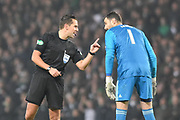 Referee Andrew Dallas has a word with Joe Lewis during the Betfred Cup Final between Celtic and Aberdeen at Hampden Park, Glasgow, United Kingdom on 2 December 2018.