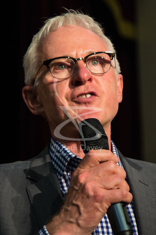 Islington Assembly Hall, London, July 16th 2015. The Liberal Democrats announce their new leader Tim Farron MP who was elected by party members in a vote against Norman Lamb MP. PICTURED: Norman Lamb MP congratulates Tim Farron with a gracious speech, in which he offered his full support.