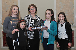 Mary Madden is pictured with her grand daughters Niamh Madden, Amy and Eabha Carney presenting the Vivienne Madden Perpetual Trophy to Eimhear Corduff at the Westport AC awards.<br /> Pic Conor McKeown