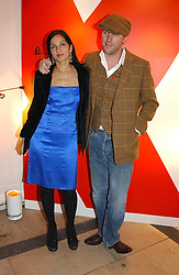 A party hosted by Mario Testino, Bianca Jagger and Kenneth Cole in collaboration with UNFPA and Marie Stopes International to celebrate the publication of Women to Woman: Positively Speaking - a book to raise awareness of women living with HIV/Aids, held at The Orangery, Kensington Palace, London on 2nd December 2004.<br />Picture shows:- SIMON & YASMIN MILLS.<br /><br />NON EXCLUSIVE - WORLD RIGHTS