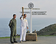 18.MAY.2012. LANDS END<br /> <br /> THE OLYMPIC FLAME WAS FLOWN EARLY THIS MORNING BY A ROYAL NAVY SEARCH AND RESCUE SQUADRON HELICOPTER FROM ROYAL NAVAL AIR STATION CULDROSE, WHERE THE FLAME HAD REMAINED OVERNIGHT, TO LANDS END FOR THE START OF THE OLYMPIC TORCH RELAY.<br /> THE 771 NAVAL AIR SQUADRON SEA KING HELICOPTER ARRIVED AT LANDS END AT 7.00 AM WHERE LIEUTENANT COMMANDER RICHARD FULL CARRIED THE LANTERN TO THE WORLD-FAMOUS SIGNPOST AT LAND'S END, AND PASSED IT OVER TO BEN AINSLE WHO IS DOING THE FIRST LEG OF THE TORCH RUN, THE TORCH WAS LIT SUPPORTED BY A CROWD OF LOCAL RESIDENTS AND DIGNITARIES.<br /> <br /> BYLINE: EDBIMAGEARCHIVE.CO.UK<br /> <br /> *THIS IMAGE IS STRICTLY FOR UK NEWSPAPERS AND MAGAZINES ONLY*<br /> *FOR WORLD WIDE SALES AND WEB USE PLEASE CONTACT EDBIMAGEARCHIVE - 0208 954 5968*