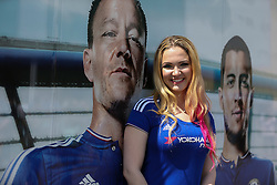 Emily from New York poses with John Terry poster outside Stamford Bridge - Mandatory byline: Jason Brown/JMP - 15/05/2016 - FOOTBALL - London, Stamford Bridge - Chelsea v Leicester City - Barclays Premier League