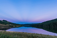 The dark blue band of Earth&rsquo;s shadow on the atmosphere rising in the southeast, fringed with the pink Belt of Venus above, and with dark anti-crepuscular rays &ndash; cloud shadows - converging on the anti-Sun point. All over Reesor Lake in the Cypress Hills of southeast Alberta. At left, the white specks in the water are American pelicans.<br /> <br /> Shot as part of a 600-frame &ldquo;holy grail&rdquo; time-lapse sequence using the TimeLapse+ View bramping intervalometer. With 24mm Sigma Art lens and Nikon D750.