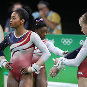 Gymnastics - Olympics: Day 4  Gabrielle Douglas of the United States. Simone Biles of the United States and  Madison Kocian of the United States prepare for the Horizontal bar during the Artistic Gymnastics Women's Team Final at the Rio Olympic Arena on August 9, 2016 in Rio de Janeiro, Brazil. (Photo by Tim Clayton/Corbis via Getty Images)
