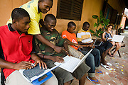 Students use laptops to browse the internet over a wireless network at the Kokrobitey Institute in the town of Kokrobitey, 30km west of Ghana's capital Accra on Sunday January 18, 2009. From left to right Reuben Sekpona, Patrick Tetteh Tamatey, Kenful Agbemenya, Abass Aryee, Joshua Sarbah, Dana Aama.