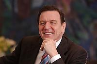 09 JAN 2002, BERLIN/GERMANY:<br /> Gerhard Schroeder, SPD, Bundeskanzler, waehrend einem Interiew, in seinem Buero, Bundeskanzleramt<br /> Gerhard Schroeder, SPD, Federal Chancellor of Germany, during an interview, in his office<br /> IMAGE: 20020109-02-043<br /> KEYWORDS: Gerhard Schröder, lacht, Lachen