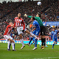 John Carew scores 1st goal as he's challenged by Brighton's Peter Brezovan<br />