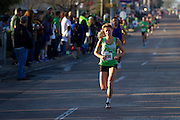 Female winner Monika Korra sprints to the finish line during the Dash Down Greenville 5k in Dallas on Saturday, March 16, 2013. (Cooper Neill/The Dallas Morning News)