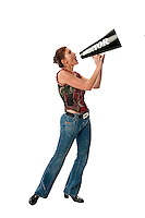 Young lady speaking into a megaphone very loud.