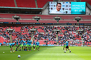 FGR players warm up with Forest Green Rovers manager, Mark Cooper on the big screen during the Vanarama National League Play Off Final match between Tranmere Rovers and Forest Green Rovers at Wembley Stadium, London, England on 14 May 2017. Photo by Shane Healey.