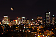 A photo of the Portland Downtown skyline from Vista with the moon in the background during the super moon in May 2012.