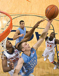 North Carolina forward Tyler Hansbrough (50) grabs a rebound from Virginia forward/center Jerome Meyinsse (55).  The the #5 ranked North Carolina Tar Heels defeated the Virginia Cavaliers 83-61 in NCAA Basketball at the John Paul Jones Arena on the Grounds of the University of Virginia in Charlottesville, VA on January 15, 2009.