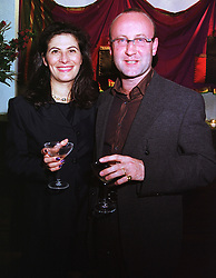 MR & MRS SEBASTIAN SAINSBURY at a party in London on 17th May 1999.MSC 29