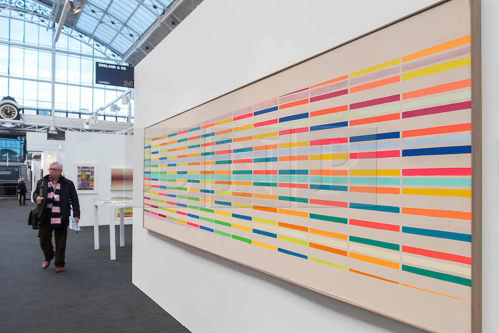 """© Licensed to London News Pictures. 17/01/2017. London, UK. """"Colour Barrier No. II"""" by John Plumb (GBP25,000), on display at the preview of the 29th London Art Fair, the UK's premier fair for Modern British and contemporary art, taking place at the Business Design Centre in Islington from 18-22 January 2017, where 129 galleries from 18 different countries will be presenting their artworks. Photo credit : Stephen Chung/LNP"""