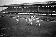16/02/1964<br /> 02/16/1964<br /> 16 February 1964<br /> Railway Cup Football Semi Final: Munster v Ulster at Croke Park, Dublin. Munster full forward, M. Burke, punches the ball past Ulster full back L. Murphy (3), but B. Brady (4), Ulster left full back comes up to clear.