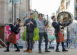 Pictured: Alasdair MacLaren (left) and Fergus Bryce (right) from Glasgow Police Pipe Band join festival headliners Finlay MacDonald and Ross Ainslie at the launch.<br /> <br /> Glasgow Police Pipe Band were on hand to make sure the launch for this years Piping Live! Glasgow Piping Festival was no quiet affair outside Glasgow Royal Concert Hall.<br /> <br /> © Dave Johnston / EEm