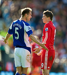 BIRMINGHAM, ENGLAND - Sunday, September 12, 2010: Liverpool's Fernando Torres and Birmingham City's Roger Johnson square up to each other during the Premiership match at St Andrews. (Photo by David Rawcliffe/Propaganda)