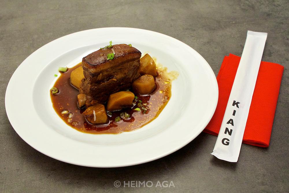 """Vienna, Austria. Kiang Winebar.<br /> """"Geschmorte Schweinebauchrippchen mit Kartoffeln (Braised Pork Ribs with Potatoes)""""."""