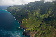 Dozens of narrow canyons meet the Pacific Ocean along the Na Pali coast of Kauai, Hawaii.