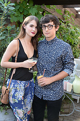 SAI BENNETT and CRAIG ROBERTS attending the Warner Bros. & Esquire Summer Party held at Shoreditch House, Ebor Street, London E1 on 18th July 2013.