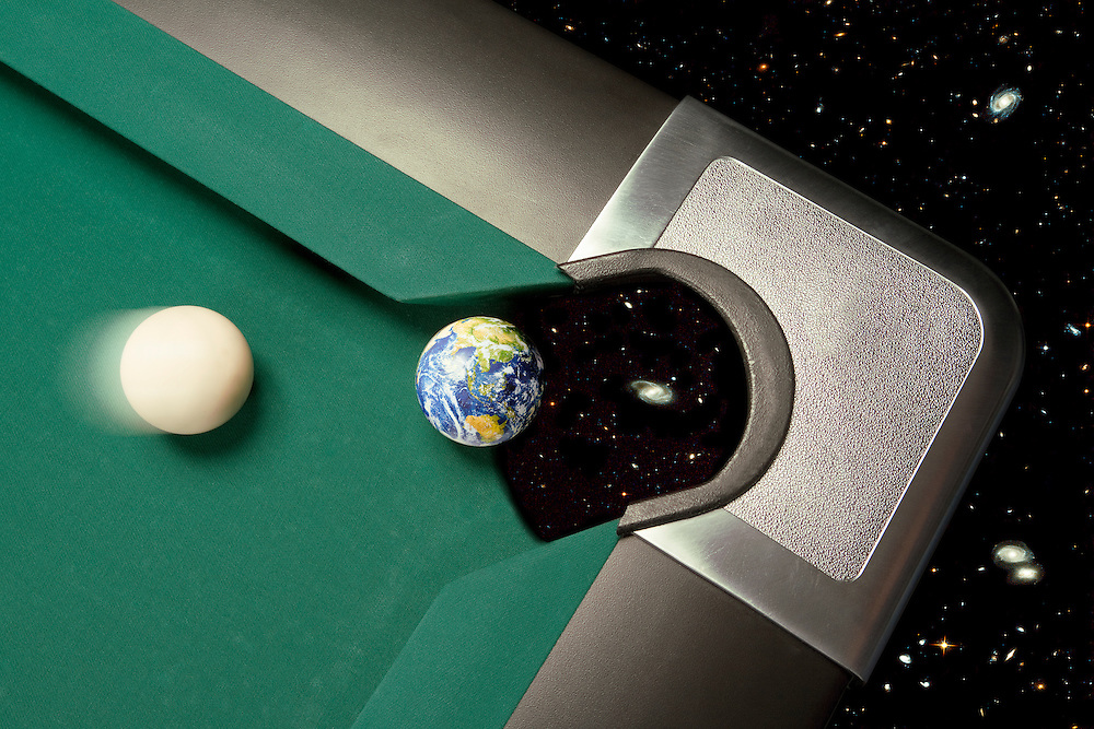 A cue ball is about to knock the Earth into a corner pocket of a celestial pool table.