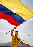A Colombia fan outside the stadium before the 2014 FIFA World Cup last 16 match at Maracana Stadium, Rio de Janeiro, Brazil.<br /> Picture by Andrew Tobin/Focus Images Ltd +44 7710 761829<br /> 28/06/2014