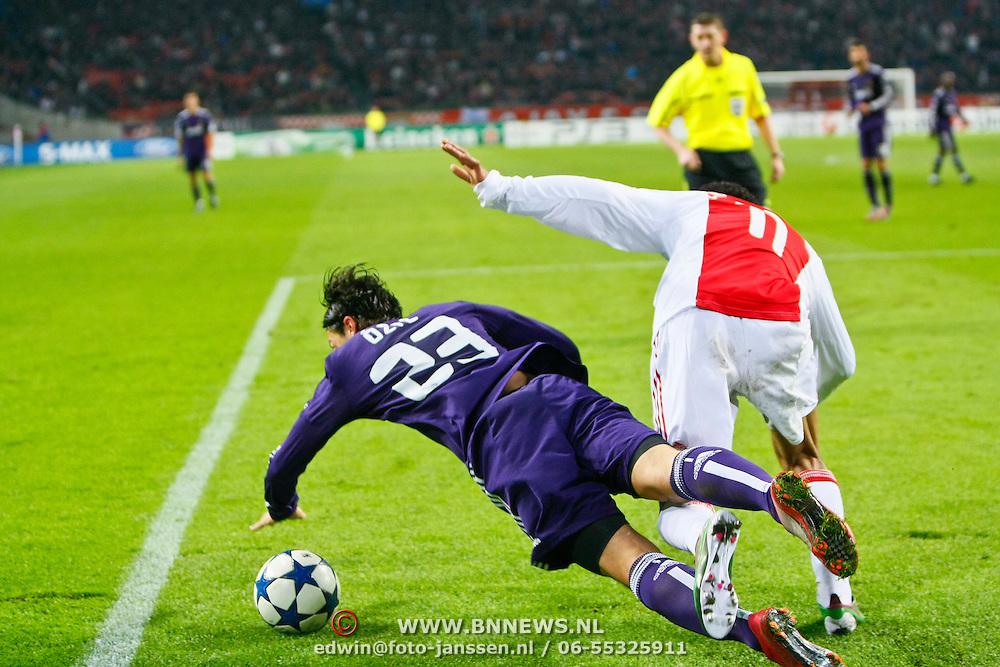 NLD/Amsterdam/20101123 - Ajax - Real Madrid, Mesut Ozil (23) / Urby Emanuelson (11)