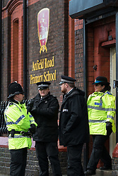 © Licensed to London News Pictures . 24/11/2015 . Liverpool , UK . Police at the scene on Anfield Road outside Anfield Infant School where it's reported shots were fired this morning (24th November 2015) . Photo credit: Joel Goodman/LNP