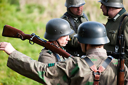 Re-enactors portraing German Panzer Grenadiers prepare for a Battle reenactment on Day one at the Showground Pickering<br />