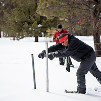 Ralphus Begay, a hydrologic technician with the Navajo Nation Department of Water measures the snowpack at the Whiskey Creek SNOTEL site in the Chuska mountains, Tuesday, Jan. 29.