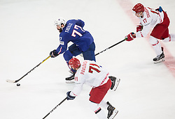 Sacha Treille of France vs Alexander Pavlovich of Belarus and Yegor Sharangovich of Belarus during the 2017 IIHF Men's World Championship group B Ice hockey match between National Teams of France and Belarus, on May 12, 2017 in AccorHotels Arena in Paris, France. Photo by Vid Ponikvar / Sportida