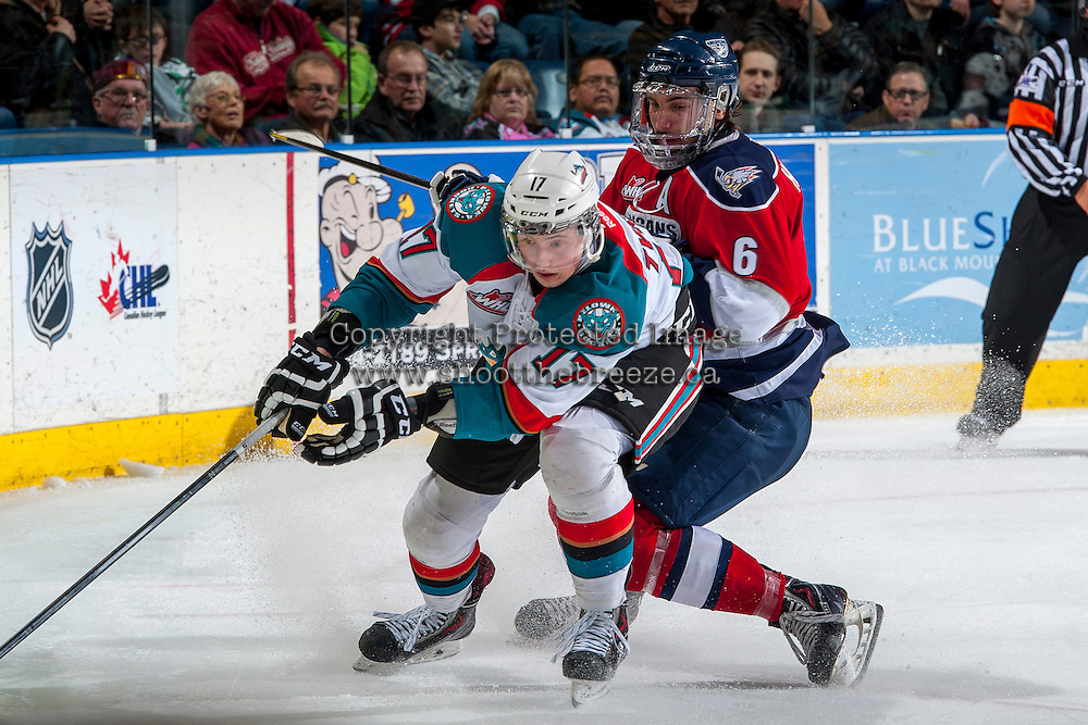 KELOWNA, CANADA -FEBRUARY 19: Marek Tvrdon #17 of the Kelowna Rockets is checked by Justin Hamonic #6 of the Tri City Americans during third period on February 19, 2014 at Prospera Place in Kelowna, British Columbia, Canada.   (Photo by Marissa Baecker/Getty Images)  *** Local Caption *** Marek Tvrdon; Justin Hamonic;