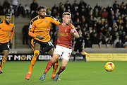 Nottingham Forest midfielder Ben Osborn and Wolverhampton Wanderers defender Dominic Iorfa battle during the Sky Bet Championship match between Wolverhampton Wanderers and Nottingham Forest at Molineux, Wolverhampton, England on 11 December 2015. Photo by Alan Franklin.