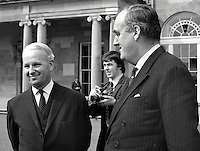 Brian Faulkner, chief executive, N Ireland Executive, left, meets William Whitelaw, first occupant of the office of Secretary of State for N Ireland, at Government House, Hillsborough, N Ireland. The photographer in the background is Derek Adams, freelance, formerly with the Ulster Star. 1975041200175BF1<br /> <br /> Copyright Image from Victor Patterson, 54 Dorchester Park, Belfast, UK, BT9 6RJ<br /> <br /> t1: +44 28 9066 1296 (from Rep of Ireland 048 9066 1296)<br /> t2: +44 28 9002 2446 (from Rep of Ireland 048 9002 2446)<br /> m: +44 7802 353836<br /> <br /> victorpattersonbelfast@gmail.com<br /> victorpatterson@me.com<br /> <br /> www.victorpatterson.com<br /> <br /> Please see my Terms and Conditions of Use at https://www.victorpatterson.com/page2<br /> It is IMPORTANT that you familiarise yourself with them.<br /> <br /> Images used on the Internet incur an additional cost and must be visibly watermarked i.e. © Victor Patterson within the body of the image and copyright metadata must not be deleted. Images used on the Internet have a size restriction of 4kbs and are chargeable at rates available at victorpatterson.com.<br /> <br /> This image is available only for the use of the download recipient i.e. television station, newspaper, magazine, book publisher, etc, and must not be passed on to any third party. It is also downloaded on condition that each and every usage is notified within 7 days to victorpatterson@me.com<br /> <br /> The right of Victor Patterson (or the named photographer) to be identified as the author is asserted in accordance with The Copyright Designs And Patents Act (1988). All moral rights are asserted.