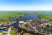 Nederland, Friesland, Gemeente Leeuwarden, 07-05-2018;  Grouw, Fries: Grou, gelegen aan het Pikmeer en het Prinses Margrietkanaal.<br /> Frisian village Grouw. <br /> <br /> luchtfoto (toeslag op standard tarieven);<br /> aerial photo (additional fee required);<br /> copyright foto/photo Siebe Swart