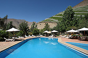 Swimming Pool at the El Galpon hotel, just outside Pisco Elqui, with the vines lining the surrounding hillsides