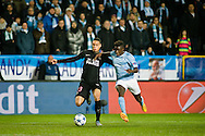 25.11.2015. Malmö, Sweden. <br /> Gregory van der Wiel (L) of Paris fights for the ball with Pa Konate (R) of Malmö FF during the UEFA Champions League match at the Malmö New Stadium.<br /> Photo: © Ricardo Ramirez.