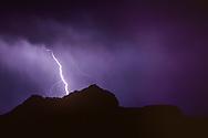 Lightning beyond the Mesa at Otowi Ruin, © 1983 David A. Ponton