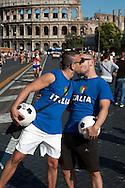 Roma 23 Giugno 2012.GayPride 2012.La Sfilata del Gay pride, la giornatà dell' orgoglio omossessuale per le vie della città..Due uomini si baciano vestiti da calciatori con le maglie dell'Italia