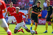 Brentford midfielder Christian Nørgaard (6) brings down Charlton Athletic forward Lyle Taylor (9) during the EFL Sky Bet Championship match between Charlton Athletic and Brentford at The Valley, London, England on 24 August 2019.