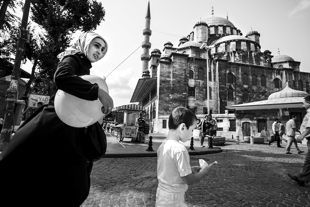 People passing behind New Mosque (Yeni Cami), in Istanbul.