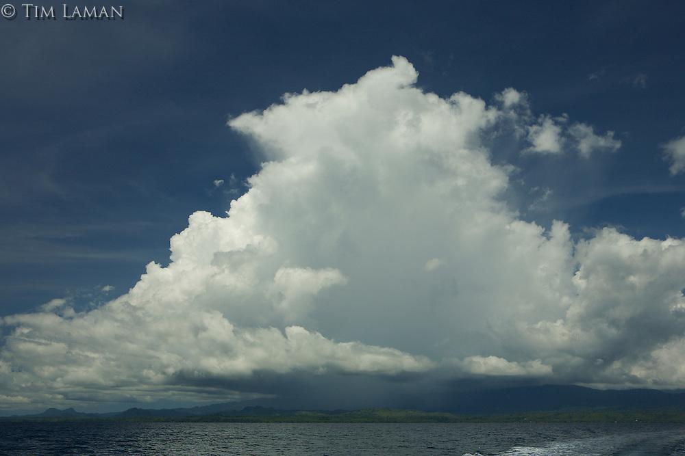 Huge rain clouds over Labilabi, Halmahera viewed from the bay.