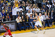 Golden State Warriors guard Klay Thompson (11) reacts to a three pointer against the Houston Rockets at Oracle Arena in Oakland, Calif., on October 17, 2017. (Stan Olszewski/Special to S.F. Examiner)