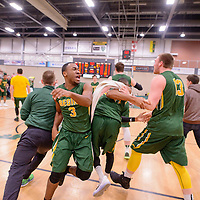 1st year guard Johneil Johnson (3) of the Regina Cougars celebrates after home game win on January  28 at Centre for Kinesiology, Health and Sport. Credit: Arthur Ward/Arthur Images