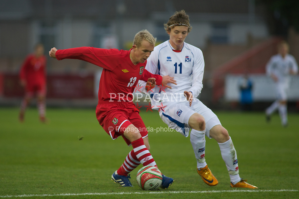 LLANELLI, WALES - Friday, October 22, 2010: Wales' Jonathan Williams in action against Iceland's Jo?n Daði Bo?ðvarsson during the UEFA Under-19 Championship Qualifying Group 1 match at Stebonheath Park. (Photo by Gareth Davies/Propaganda)